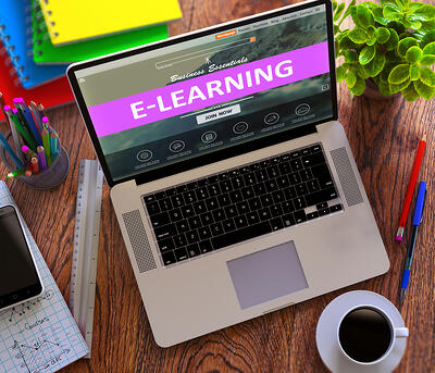 E-Learning on Laptop Screen. Online Working Concept.